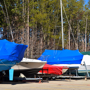 Some boats in a storage yard